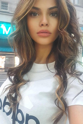 Stunning young London escort taking a selfie in the street