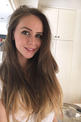Naturally beautiful brunette with big green eyes in a selfie